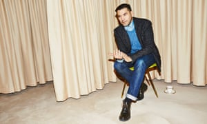 Roland Mouret sitting in a chair, leaning forward