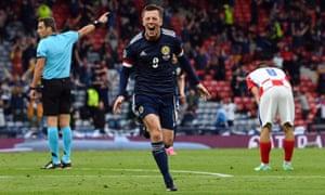Scotland's Callum McGregor celebrates scoring their equaliser.