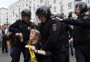 Police officers detain Maria Baronova, a coordinator of Mikhail Khodorkovsky's Open Russia organisation, as she participates in an unauthorised opposition rally in central Moscow