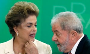 Brazil's former president, Luiz Inácio Lula da Silva, right, is sworn in as the new chief of staff of President Dilma Rousseff, left.