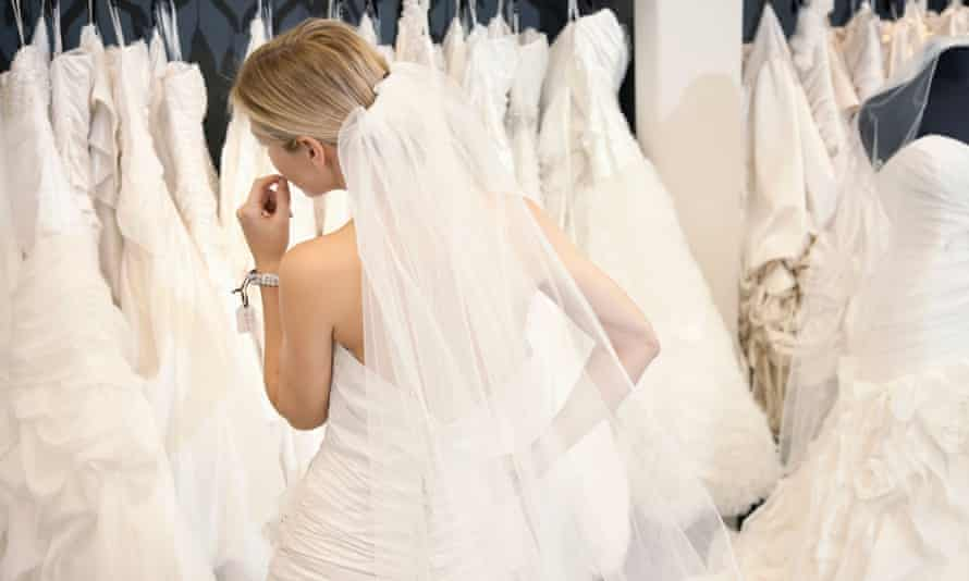 Woman looking at bridal gowns