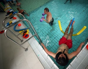 Patients participate in a physiotherapy class in the hydrotherapy pool in the Physiotherapy department at Milton Keynes University, 8 June.