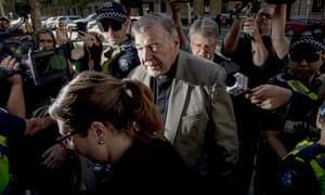 George Pell surrounded by media