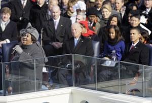 Joe Biden, Barack Obama and Malia Obama watch at the US Capitol in Washington, as Aretha Franklin performs during Obama's inauguration ceremony, 20 January 2009