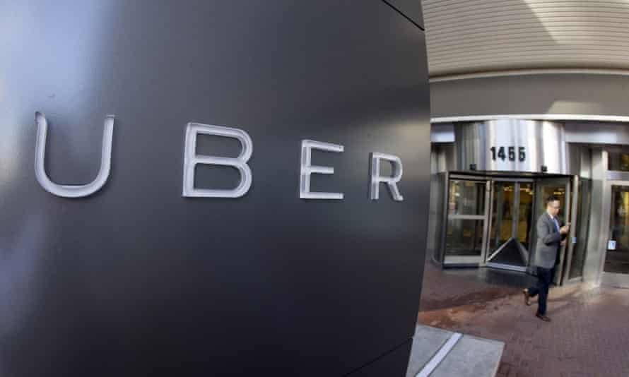 The Uber logo in front of a building