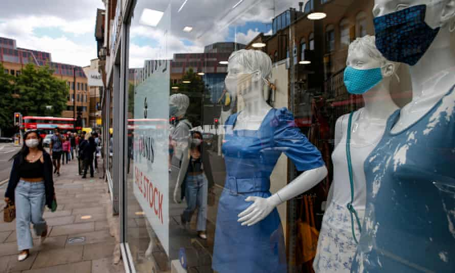 Mannequins wearing face masks in a shop window in Islington, north London.