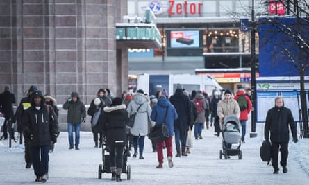 People walking outside Helsinki Central railway station in Finland in 2017.