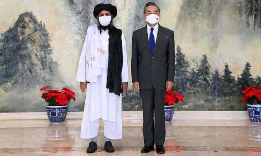 The Chinese foreign minister, Wang Yi, meets the Taliban's Abdul Ghani Baradar in Tianjin, China, last month.