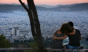 Better times ahead? People watch the sun set from Lycabettus Hill in Athens.