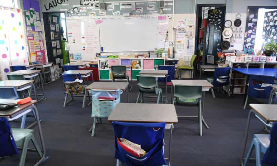 empty chairs and desks in a schoolroom