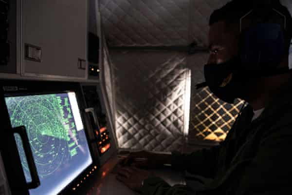 An Ecuadorian navy officer looks at a radar after the mostly Chinese-flagged fleet was detected in an international corridor that borders the Galápagos Islands.