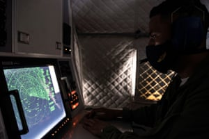 An Ecuadorian navy officer looks at a radar after the mostly Chinese-flagged fleet was detected in an international corridor that borders the Galapagos Islands.