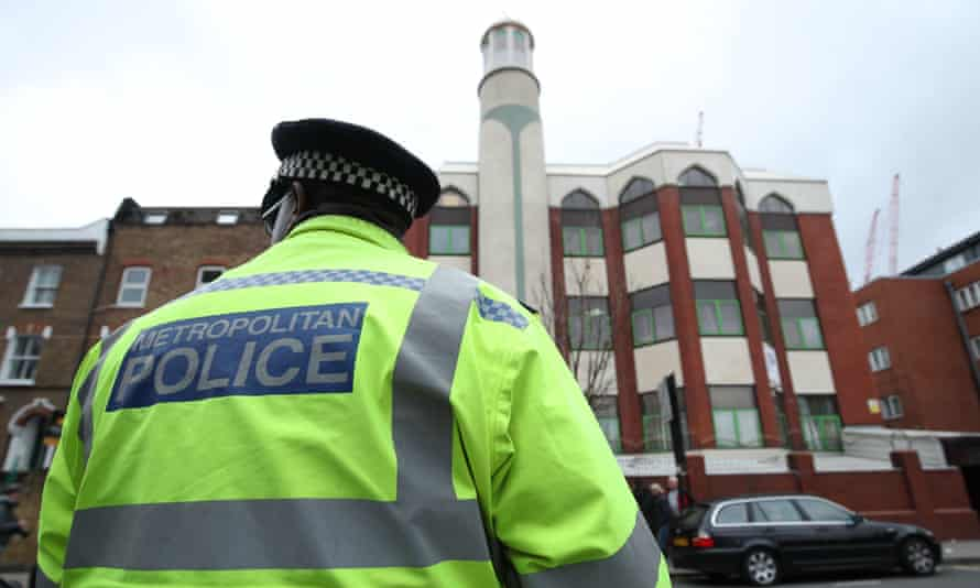 A police officer stands opposite Finsbury Park mosque in London on Friday following the attacks in Christchurch, New Zealand