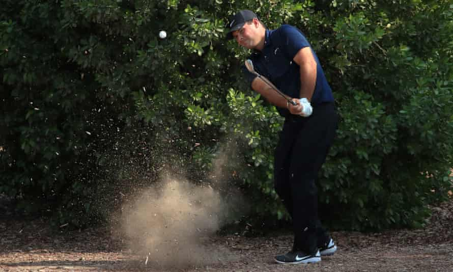 Patrick Reed plays his third shot out of trouble on the second hole