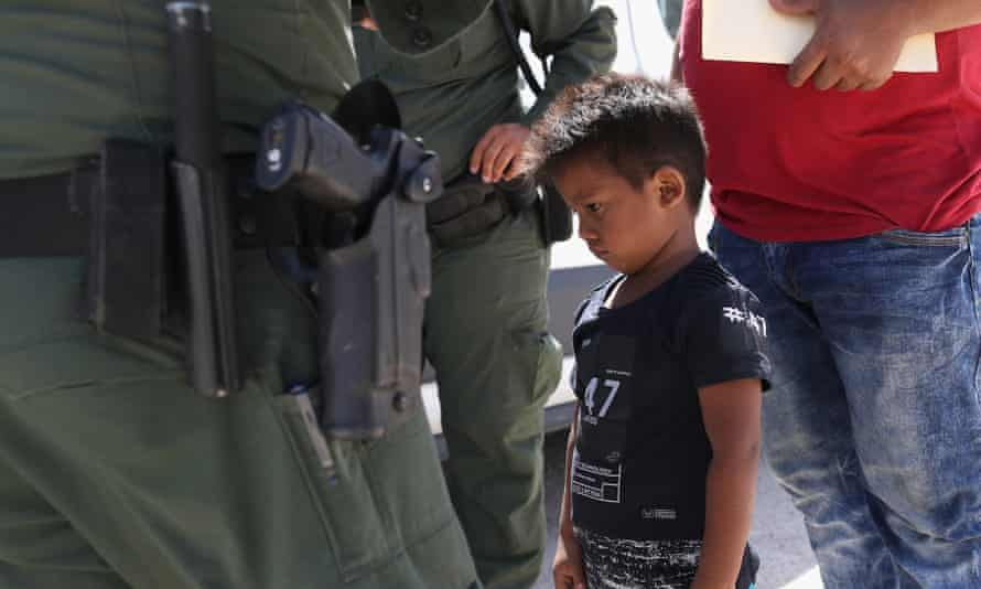A boy and his father from Honduras are taken into custody by US border agents near the US-Mexico Border on 12 June.