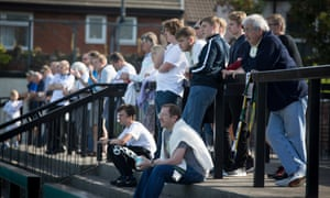Marine supporters watch their team during a sun-drenched day in Crosby, a Merseyside town located about a half a mile from the Irish Sea.