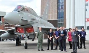 David Cameron observes work on a Eurofighter Typhoon during a visit to BAE Systems in Warton, Lancashire.