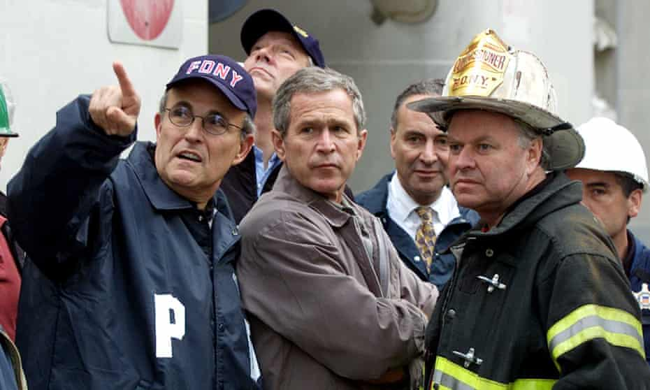 Giuliani with Bush and fire commissioner Thomas Van Essen just after the 9/11 attacks in 2001.