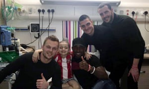Sunderland footballers (left to right) Seb Larsson, Jermain Defoe, Vito Mannone and John O'Shea with Bradley.