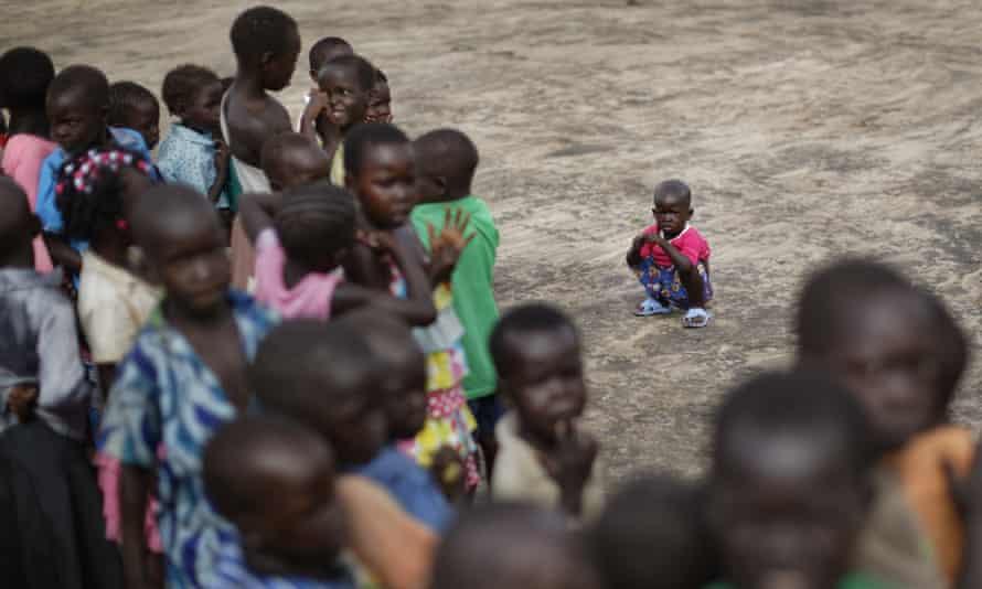 South Sudanese refugee children line up before class in Bidi Bidi refugee settlement, northern Uganda.