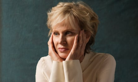 Siri Hustvedt leaning on her hands looking slightly away from the camera