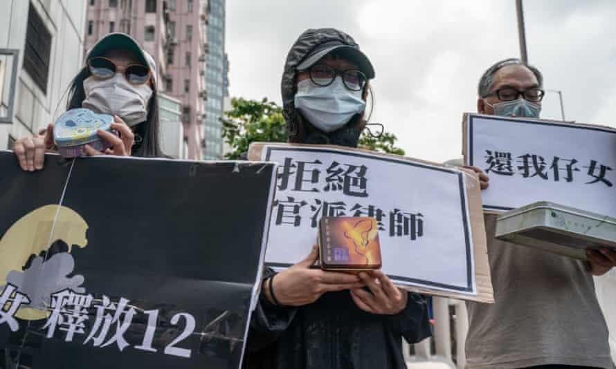 Family members of the Hong Kong residents detained in China protest outside the Liaison Office of the Central People's Government on 30 September.