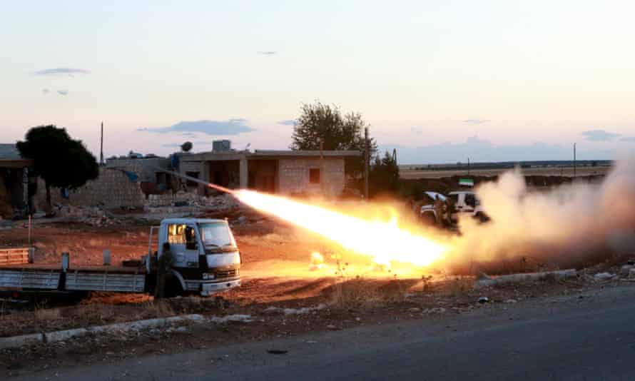 Free Syrian Army Sultan Murad Brigade members fire a rocket in the town of Azaz town in Aleppo.