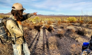 A volunteer scouts routes across the Sonoran Desert.