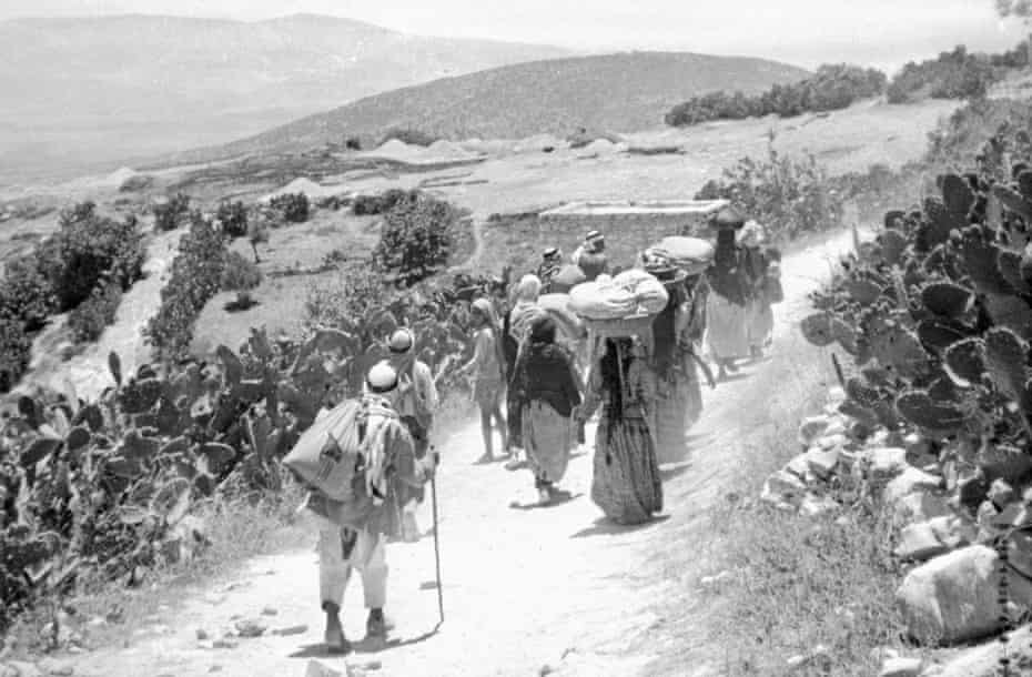 Palestinians after the surrender of their village in 1948.