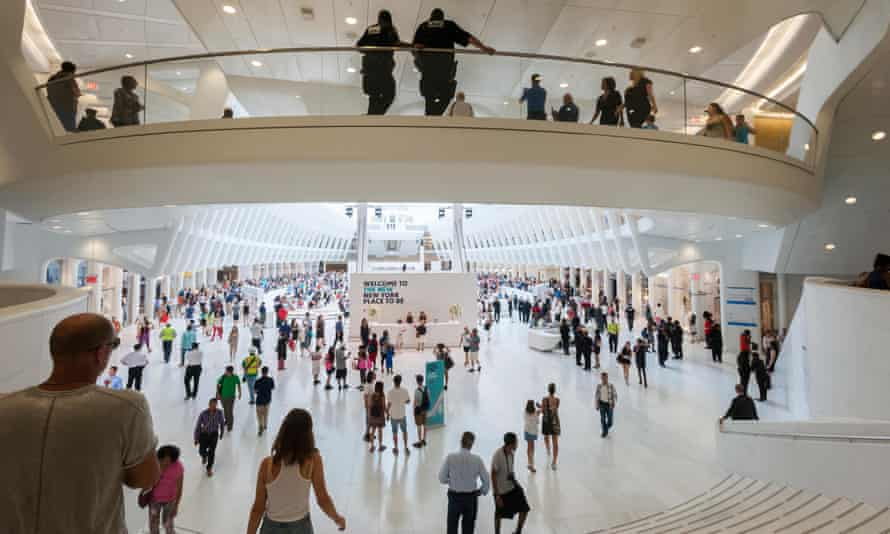 Thousands of visitors pack the World Trade Center transportation hub for the grand opening of the retail spaces.