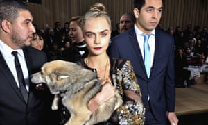 Cara Delevingne and front row dog Leo.