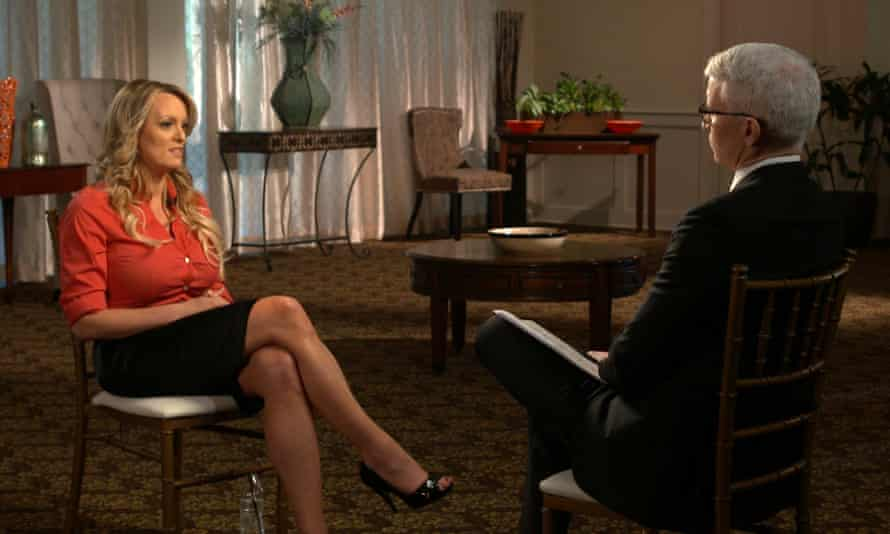 This image released by CBS News shows Stormy Daniels with Anderson Cooper.