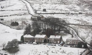 Snow covered homes in Overwater, Cumbria on Sunday following heavy snowfalls across northern England.