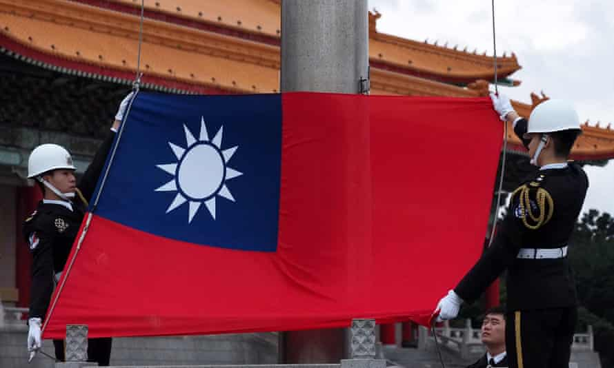 Guards hold a Taiwanese flag
