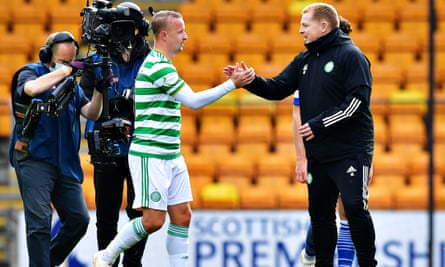 Leigh Griffiths is congratulated by his Celtic manager, Neil Lennon, after scoring in a 2-0 win against St Johnstone at McDiarmid Park.
