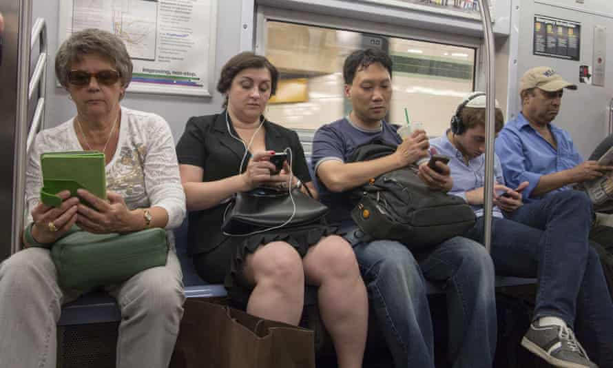 Subway riders on phones/tablets