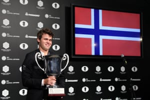 Carlsen celebrates with the trophy.