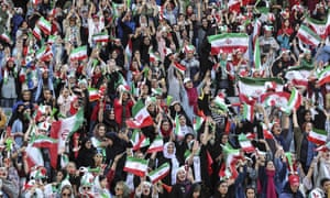 Crowd of female football fans in Iranian flag colours