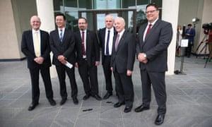 Crossbench senators from left; David Leyonhjelm, Dio Wang, Ricky Muir, John Madigan, Bob Day and Glenn Lazarus at the senate doors of Parliament House on Wednesday.