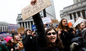 A group of students, who walked out of New York-area schools, gather for a protest against the Trump administration in New York Tuesday.