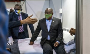 South African President Cyril Ramaphosa visits the Covid-19 treatment facilities at the NASREC Expo Centre in Johannesburg, South Africa, 24 April 2020.