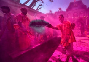 Throwing powders and water at Gokul Dham Temple in Mathura, a city in the northern state of Uttar Pradesh where Lord Krishna is said to have been born