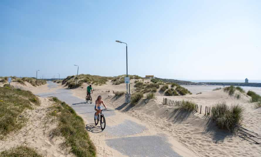 Cyclists on Trecco Bay seafront in Porthcawl during the coronavirus lockdown.
