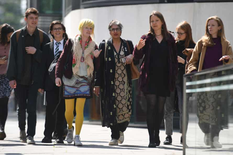 Extinction Rebellion activists, including Farhana Yamin (C) arrive for a meeting with the environment secretary, Michael Gove, on Tuesday.