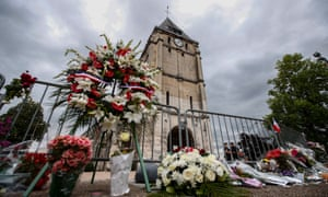 Flowers outside  Saint-Étienne-du-Rouvray church where Father Jacques Hamel, 85, was killed while celebrating mass
