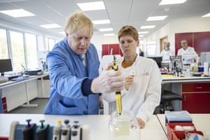 Boris Johnson visits the Mologic Laboratory in Bedfordshire, where scientists are working on quicker testing for Covid-19, 6 March.