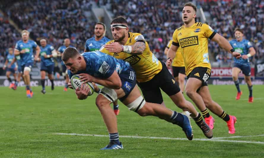 Dalton Papalii scores a try for Blues as TJ Perenara attempts a tackle in their 30-20 win on Sunday