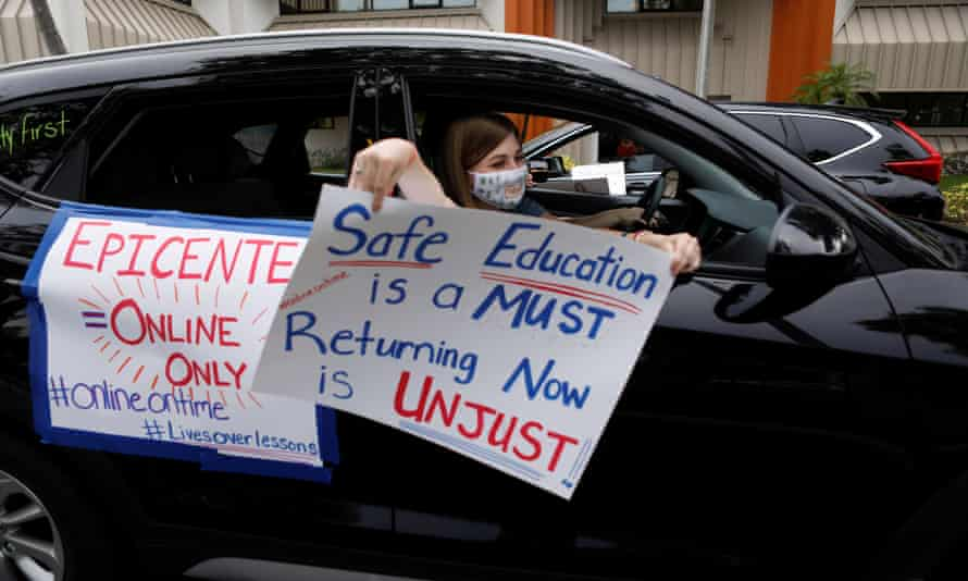 Florida teachers hold a car parade protest in front of the Pasco county school district office on 21 July.