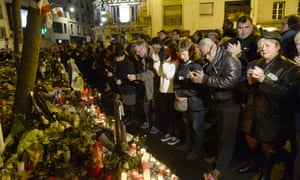 """People applaud while uniting for a tribute at a makeshift memorial for the victims of a series of deadly attacks in Paris, near the """"Belle Equipe"""" cafe on rue de Charonne in Paris on November 20, 2015."""