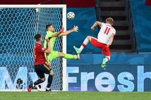 Poland's Karol Swiderski shoots at goal.